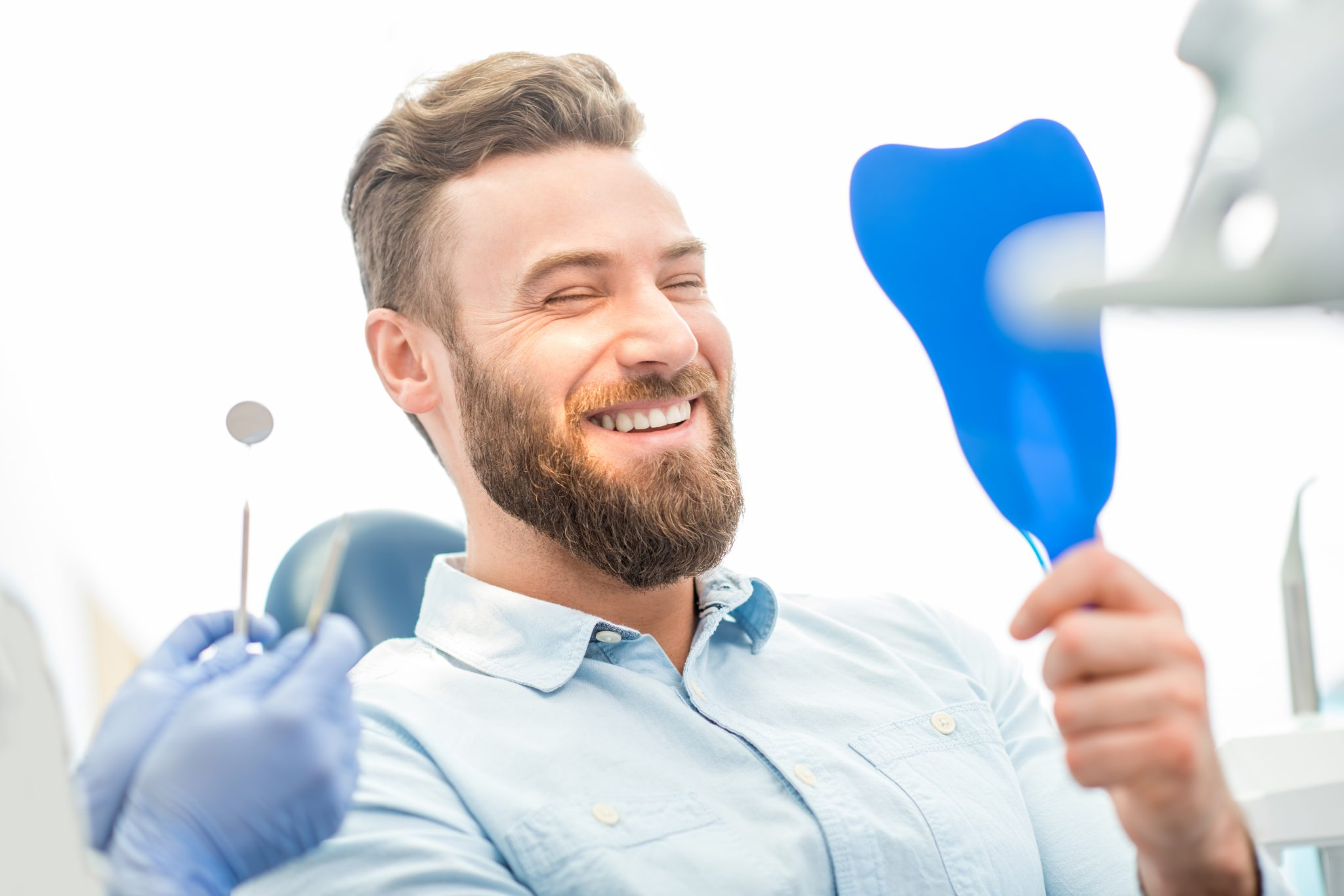 Man With Great Smile At The Dental Office