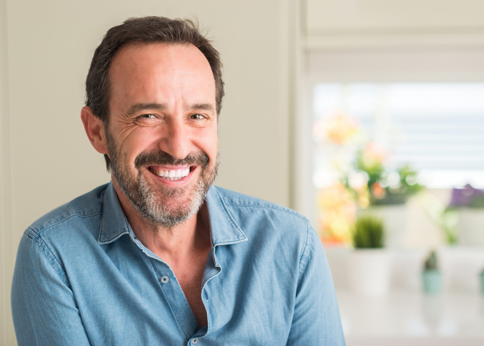 Handsome Middle Age Man With A Happy Face Standing And Smiling With A Confident Smile Showing Teeth