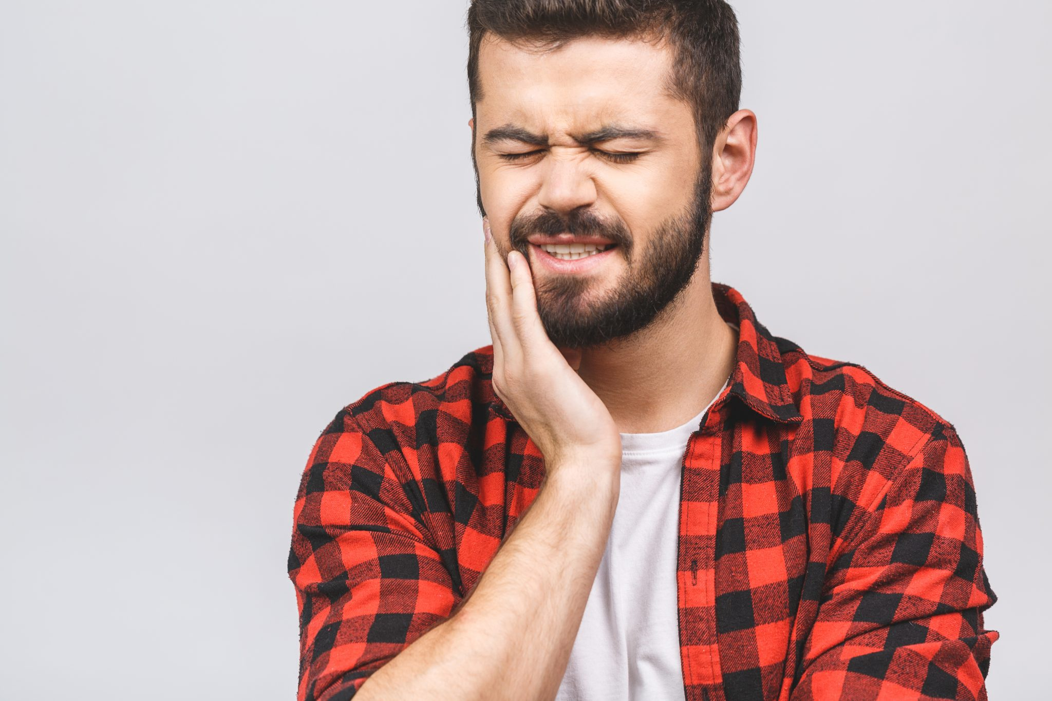 Close Up Portrait Of Nervous Unhappy Troubled Handsome Bearded Man Touching His Cheek He Has Toothache Isolated On White Background Copy Space.