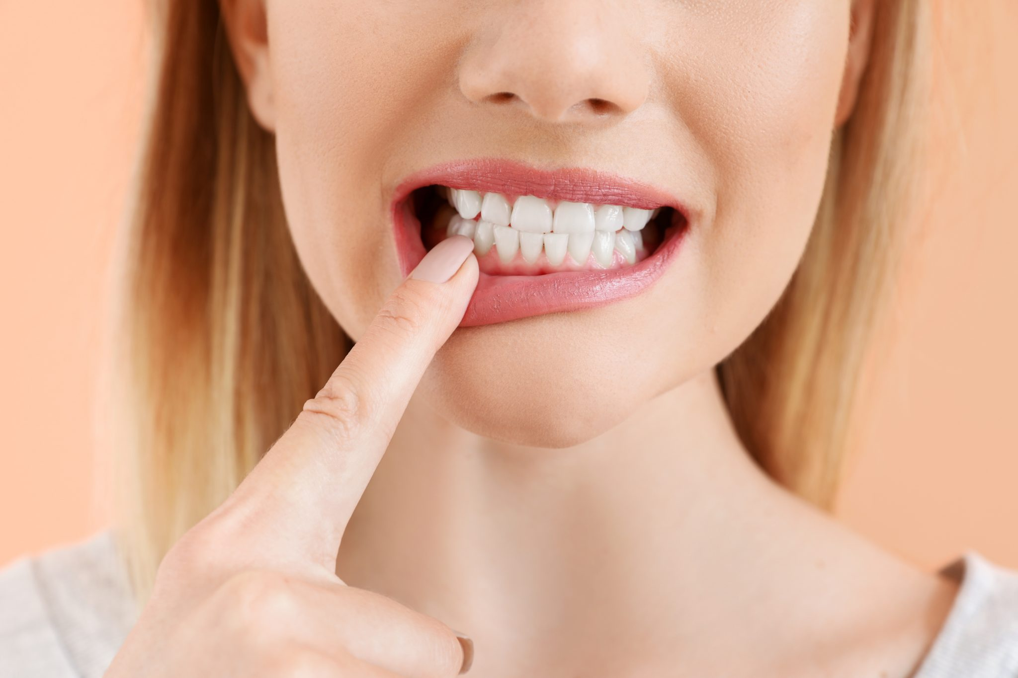 Beautiful Woman With Healthy Teeth On Color Background, Closeup